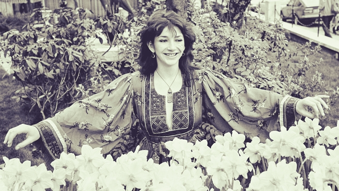 British singer and song writer Kate Bush, pops up from the daffodils at the Inn-on-the-Park, London